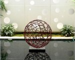 Installation - painted steel sphere (90 cm) & perforated aluminium wall (6m x 6m)